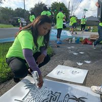 Yvette Colbourne painting sidewalk enhancement